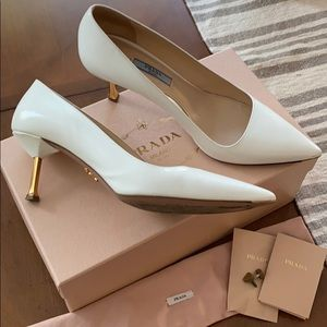 White saffiano with metal heels.